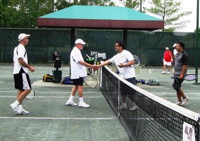 The father-son team of Paul and David Kramer, left, shakes hands with their opponents, A.J. Almanzor and Romeo Laurente, after a B-Division match during the 22nd annual Volley For SERV Tennis Tournament fundraiser at Cherry Valley Country Club.