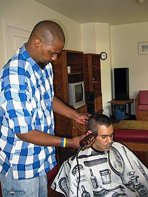 Using tools he bought with funds from the SERV Foundation, Wayne gives a haircut to fellow SERV consumer, Carlos, at the Serenity House in Mercer County.